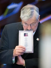 Iowa Gov. Terry Branstad takes a moment while waiting to leave the sanctuary during the funeral of Omaha police detective Kerrie Orozco at St. John's Catholic Church at Creighton University in Omaha on Tuesday. Orozco grew up in Walnut, Ia.