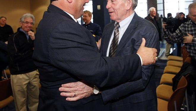 Michigan coach Brady Hoke and ex-coach Gary Moeller