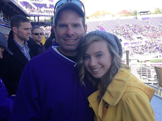 Mike Ruckman and his daughter Mandy, 18, at James Madison's football game against Elon on Nov. 22 at Bridgeforth Stadium in Harrisonburg.