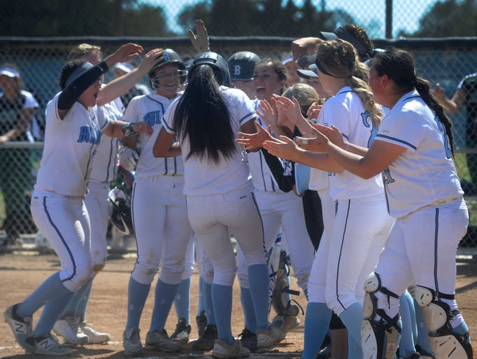 Jenessa Ullegue is surrounded by Buena teammates at