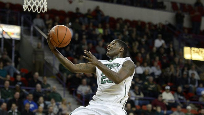UW-Green Bay's Daeshon Francis lays up a shot during a Horizon League game against UW-Milwaukee at the Resch Center in Ashwaubenon in February.