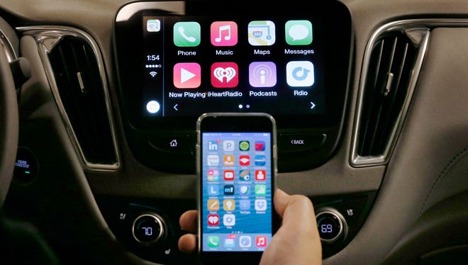 An iPhone is connected to a 2016 Chevrolet Malibu equipped with Apple CarPlay apps, displayed on the car's MyLink screen. With  220 million Internet connected cars expected to be on the roads within five years, a national security expert visited Detroit Tuesday and urged automakers to be mindful of the growing cyber-security threats posed by terrorists, information crooks and spies who could potentially try to hack into wired vehicles and cause mayhem of all sorts.