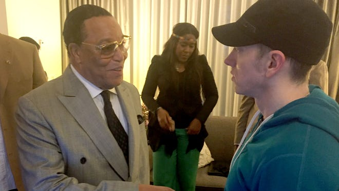 Minister Louis Farrakhan of the Nation of Islam meets in Detroit with rapper Eminem on Aug. 25, 2015.