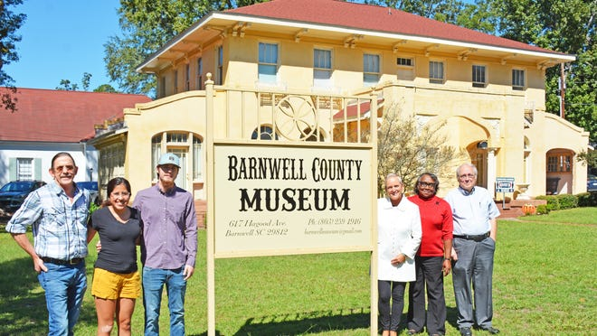 TNT Printwear in Barnwell donated a new sign to the Barnwell County Museum. Pictured (left to right) are Terry Padgett, Jacob Padgett and Perla Padgett of TNT along with Barbara Harber (museum director/acting curator), Virginia Geter (museum office manager), and Milton Harden (museum board chairman).