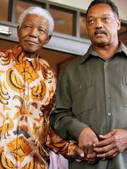 Former South African president Nelson Mandela, left,