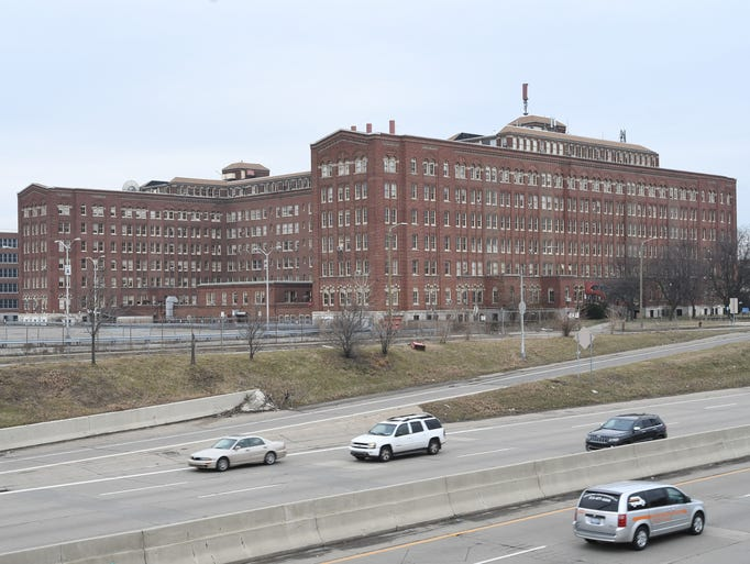 The vacant Herman Kiefer Hospital complex looms along