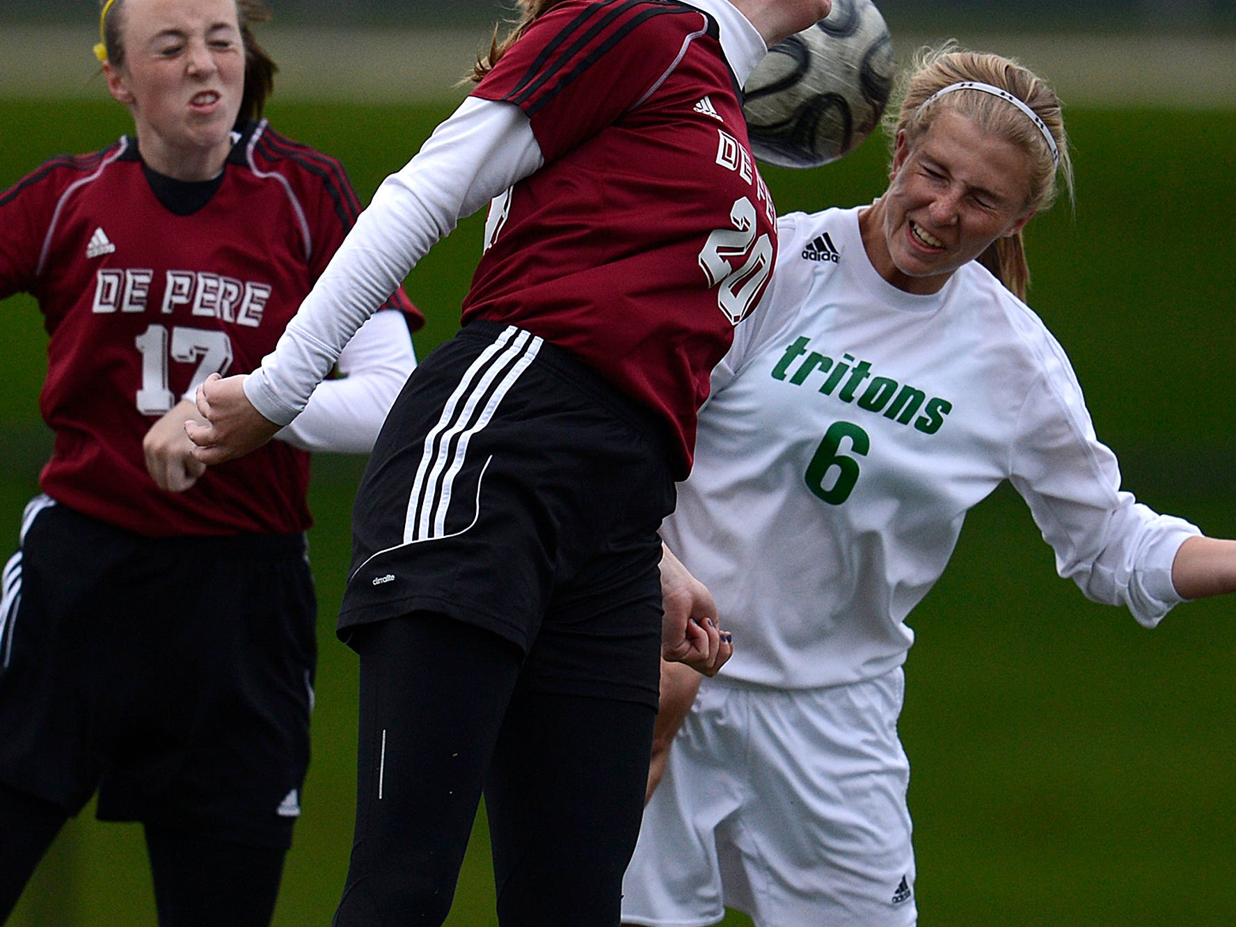Green Bay Notre Dame's Grace Shaw (6) battles De Pere's Lizzie Miller (20) and Anna Boyd (17) for a header in the second half during a FRCC soccer game last week.