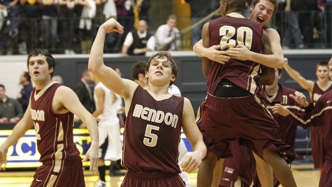 Mendon players react to beating rival Sutherland during the 2010 Rainbow Classic at the University of Rochester.