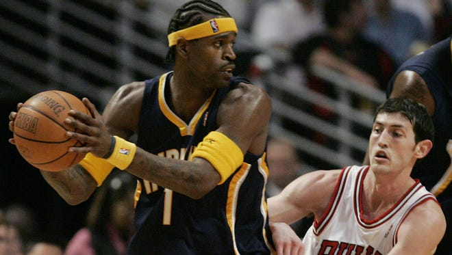 Indiana Pacers' Stephen Jackson (1) looks to pass as Chicago Bulls' Kirk Hinrich defends during the fourth quarter of an NBA game in Chicago, Tuesday, April 4, 2006. The Bulls won 102-96.