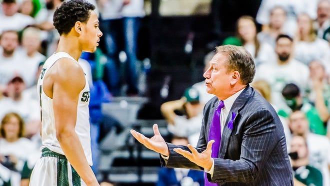 MSU men's basketball head coach Tom Izzo, right, speaks with Bryn Forbes in the 1st half of their game with Illinois.