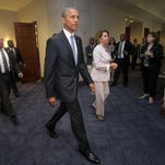 President Barack Obama and House Minority Leader Nancy Pelosi of California leave a meeting with House Democrats on Capitol Hill in Washington to discuss the global trade talks on June 12.