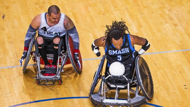 Ernie Chun, left, of the 360 Heat, #8, chases James Adams of the Shepherd Smash at the 2018 USQRA Wheelchair Rugby National Championships at the Ability 360 Sports and Fitness Center in Phoenix, Thursday, April 19, 2018. The tournament runs through Saturday, April 21.