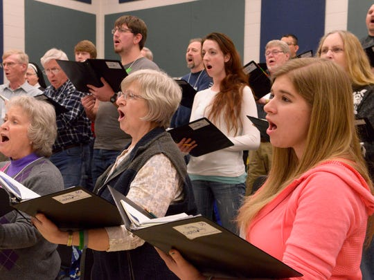 In this 2015 photo, Capitol Civic Centre Community Chorale members Lucy Zeldenrust (from left), Barbara Kussman and Michelle Klavekoske rehearse.