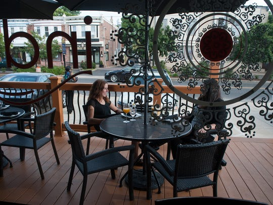 Customers enjoy the porch of IndeBlue in Collingswood.