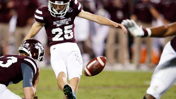 Mississippi State kicker Westin Graves (25) kicks a field goal against LSU during the second half of an NCAA college football game in Starkville, Miss., Saturday, Sept. 12, 2015. No. 14 LSU won 21-19. (AP Photo/Rogelio V. Solis)
