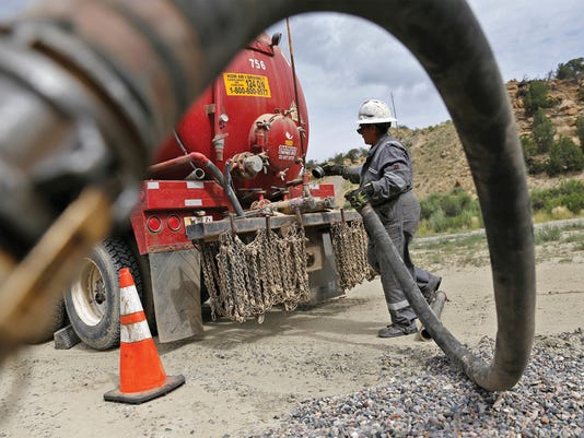 Aztec Well Servicing Co. water truck driver Saybra Greybear services an oil and gas well July 14 near Blanco.