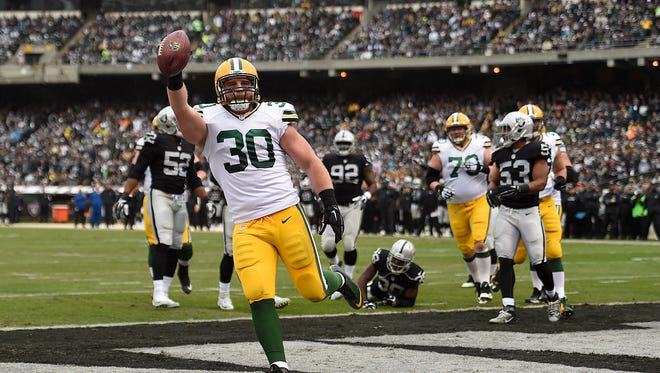 Green Bay Packers fullback John Kuhm (30) scores a touchdown against the Oakland Raiders at O.co Coliseum.