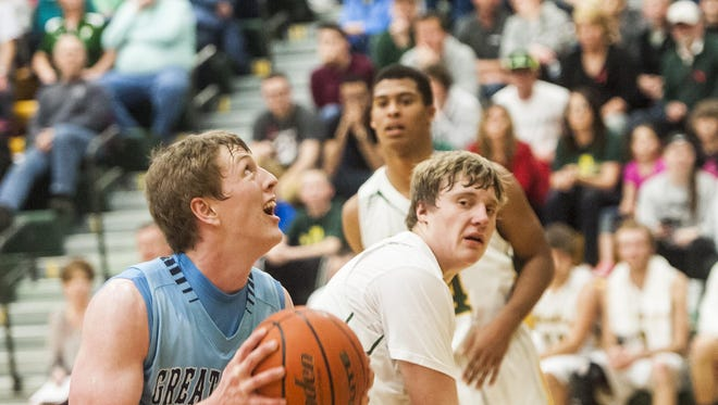 Great Falls' Brendan Howard shoots around CMR players during the crosstown game Thursday.