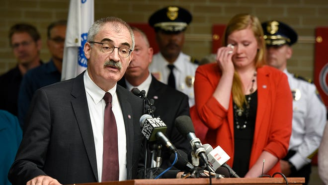 Chancellor of the Minnesota State Colleges and Universities system Steven Rosenstone talks about the loss of St. Cloud State University President Earl H. Potter III while SCSU Student Government President Mikaela Johnson wipes away tears during a press conference Tuesday, June 14, at St. Cloud State University. SCSU President President Earl H. Potter III died in a one-vehicle crash Monday night in Brooklyn Center.