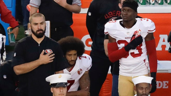 FILE - In this Thursday, Sept. 1, 2016 file photo, San Francisco 49ers quarterback Colin Kaepernick, kneels during the national anthem.