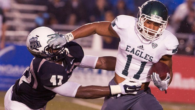 Eastern Michigan senior receiver Tyler Allen, a Lansing Eastern grad, tries to fight for extra yardage during last week's contest against Old Dominion.