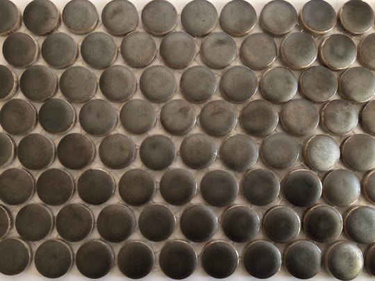 Bronze penny round tile from Dal Tile