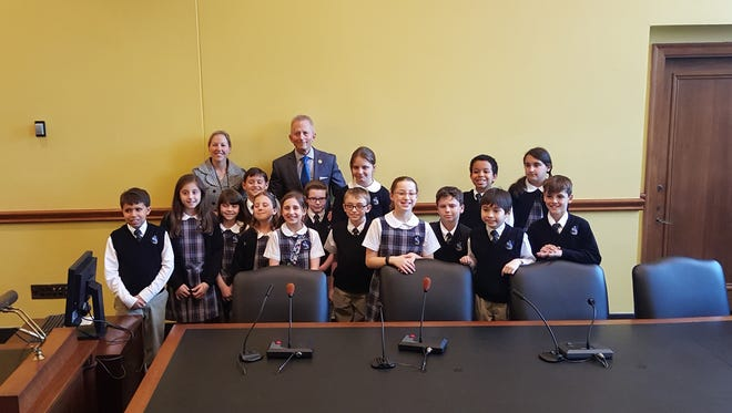 Jody Garton and her fourth-grade class from St. Mary School visit state Sen. Jeff Van Drew in Trenton.