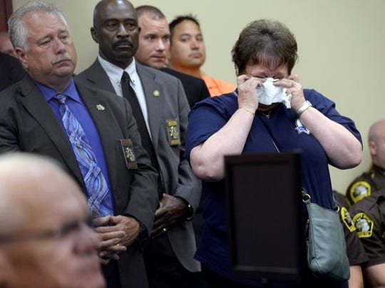 Members of the Ingham County Sheriff's Department and supporters listen to Mary Whitaker's statement before John Kelsey is sentenced.