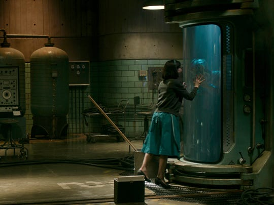 """Sally Hawkins (left) plays a cleaning woman who bonds with a creature (Doug Jones) confined in a government lab in """"The Shape of Water."""""""