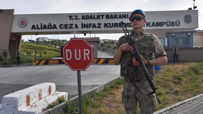 A Turkish soldier guards the entrance to the prison complex in Aliaga, Izmir province, western Turkey, where jailed US pastor Andrew Craig Brunson is appearing on his trial at a court inside the complex, Monday. The 50-year-old evangelical pastor from Black Mountain, North Carolina, faces up 35-years in prison in Turkey, on charges that he aided terror groups and engaged in espionage. The pastor of the Izmir Resurrection Church denies any wrongdoing. ()