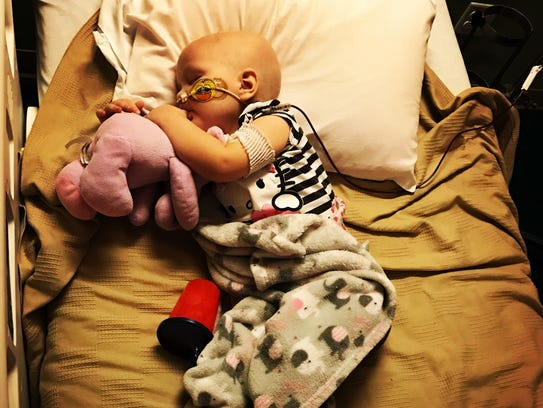 Scarlett Griffith cuddles with a stuffed animal after