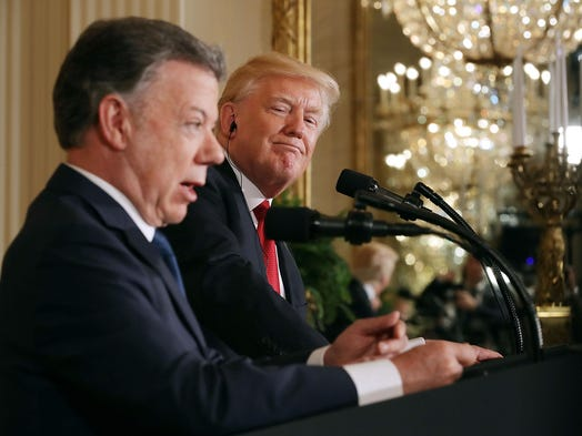 President holds up Ford and GM as examples of job expansion during same wee…
