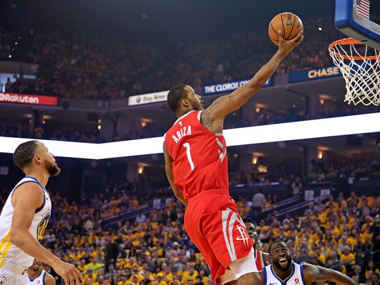 May 20: Trevor Ariza goes up for a layup past Stephen Curry during the first quarter of Game 3.