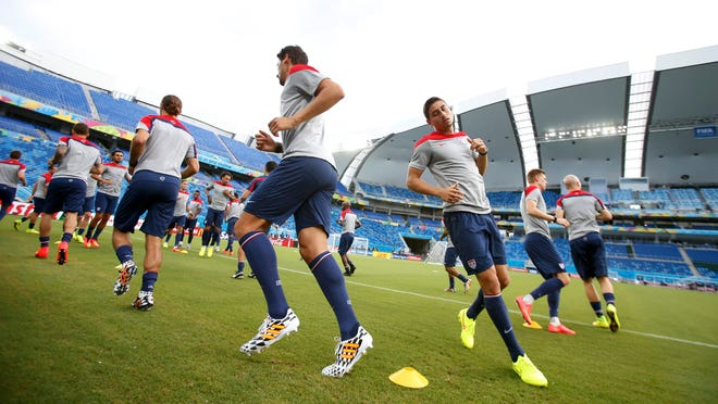 United States soccer players go though a final workout Sunday at Dunas Arena in Natal, Brazil, before Monday's World Cup opening game against Ghana.