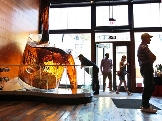 Visitors of The Evan Williams Bourbon Experience are greeted by a giant bourbon glass on the main floor. The craft distillery offers a guided tour of this artisanal bourbon-making process on West Main Street in Downtown Louisville. There's also plenty of history about Evan Williams as well as bourbon to buy. April 25, 2014