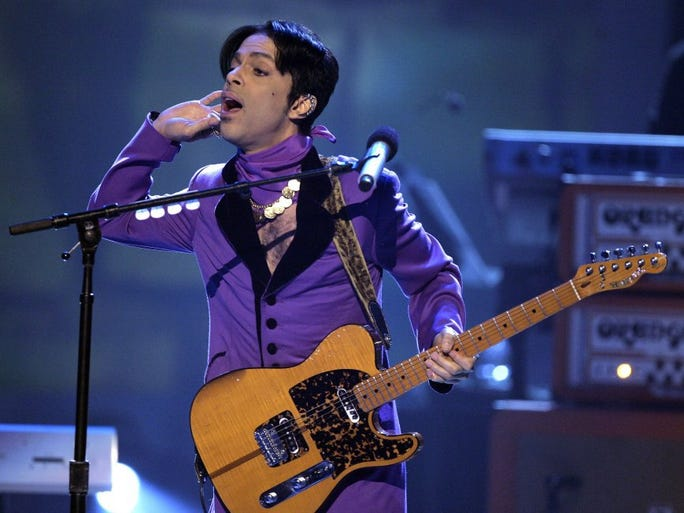 Prince performs during the 6th annual BET Awards on Tuesday, June 27, 2006, in Los Angeles. The Rock Hall of Fame inductee has died at his Paisley Park compound in the Minneapolis suburb of Chanhassen. He was 57.