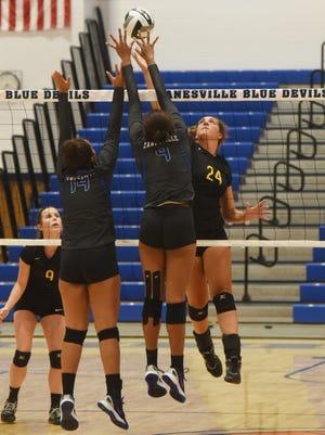 Tri-Valley's Claudia Frueh tries to tip the ball over Zanesville's Tasia Staunton.