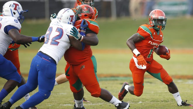 FAMU's Keonte Cash, left, blocks for running back Devondrick Nealy during the Rattlers game against Tennessee State in 2015.