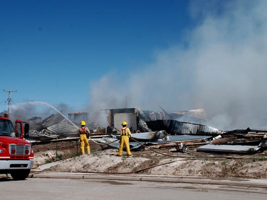 A Carrizozo house burned nearly to the ground Friday.