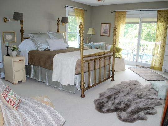 The large master bedroom provides access to a private