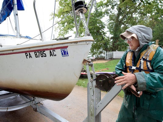 Susquehanna Yacht Club member Phil De Rosa of York Township secures a winch after trailering his Catalina 22 sailboat at the club Thursday, Oct. 1, 2015. Prompted by the threat of flooding on the Susquehanna River, many boaters were dry docking their boats. Bill Kalina - bkalina@yorkdispatch.com