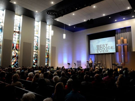 MIKE LAWRENCE / COURIER & PRESS Jeff Kinkade lead pastor at Evansville's City Church speaks at the Feb. 21, 2016, grand opening worship service in the then newly renovated church in the old St. John's United Church of Christ building.