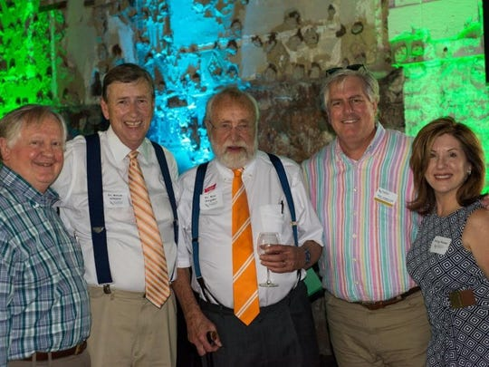 Victor Ashe, Bruce Wheeler, Bill Snyder, Daryl Johnson and Polly Fisher visit at the Emporium for the East Tennessee Community Design Center's Urban Home & Garden Tour Preview Party.