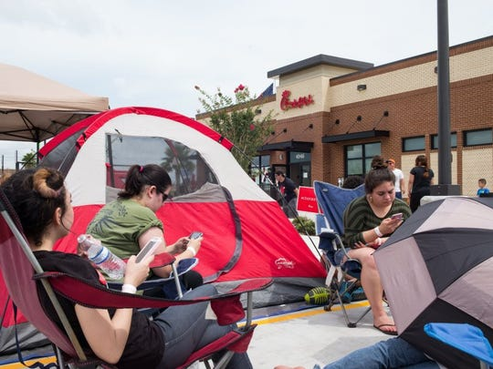 People sit in chairs outside of the Chick-fil-A at Staples and McArdle to be one of the first 100 people to win free Chick-fil-A for a year when the restaurant first opened.(COURTNEY SACCO/CALLER-TIMES)