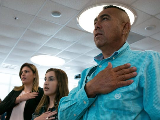 COURTNEY SACCO/CALLER-TIMES New U.S. citizens say the Pledge of Allegiance during their citizenship oath ceremony in 2016 at the U.S. District Court for the Southern District of Texas.