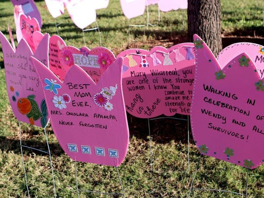 In this file photo, messages of love and support for breast cancer survivors are displayed near the finish line of the Race for the Cure in downtown Wichita Falls.