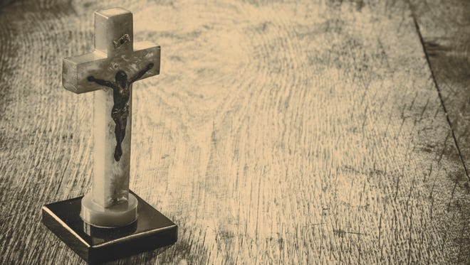 Old cross with jesus on the old wooden floor