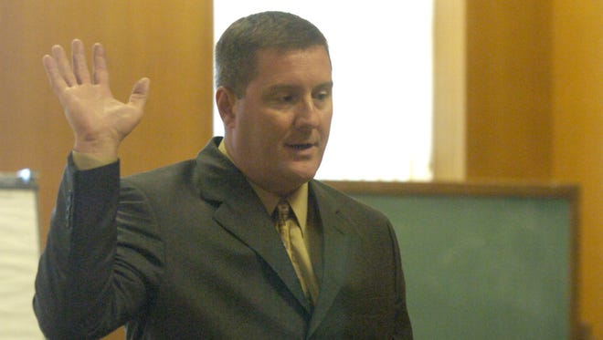 Sheriff Thomas Reichert is sworn in to the office in 2005.