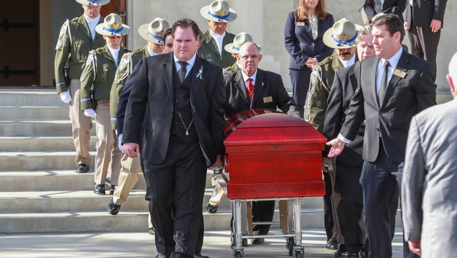 Pallbearers escort the casket of John Benoit after services at St. Francis of Assisi in La Quinta, January 10, 2016.