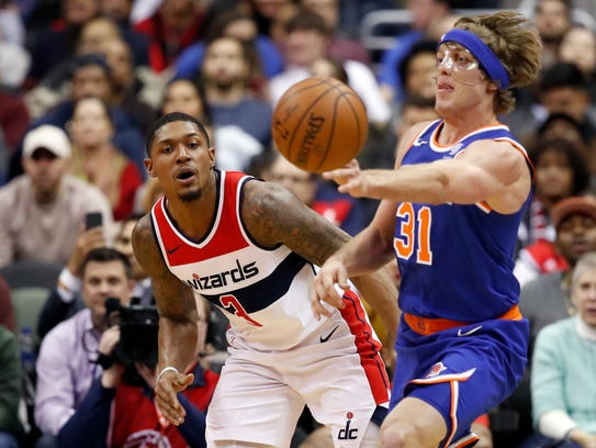 Knicks guard Ron Baker passes the ball in front of